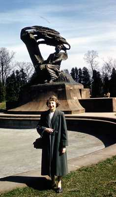 Evelyn Thurman in Warsaw, Poland with Chopin Statue (SC 2834)