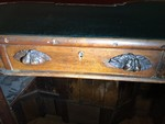 Pear-shaped Handles on Drawer of Desk by Olivia Renee Bowers